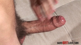 Damian Boss strokes his fat uncut cock