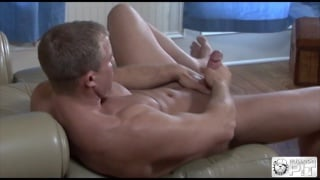Trent Tarzan plays with Ross Mitchell on massage table