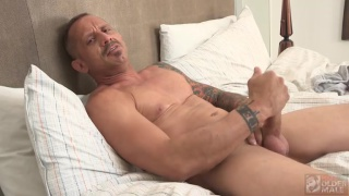 Kyle Savage pleasures his cock with both hands