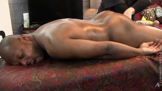 beefy black guy Shea on massage table