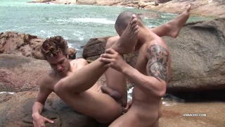 latino guys fuck on beach with waves crashing into shore