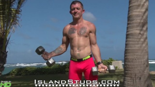 muscle daddy pumps iron outdoors