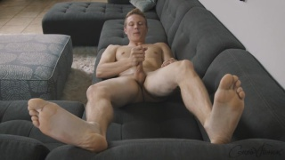 blond stud Griffin relaxes and pleasures his cock