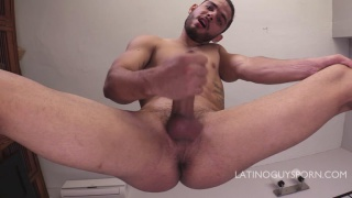 LAtino Guy plays with his foreskin