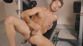 bearded college stud jacks off in home gym