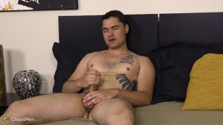 Owyn strokes his cock in first porno