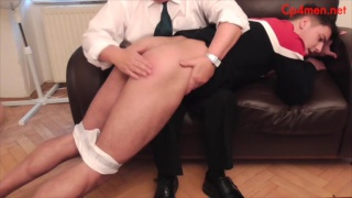 young lad goes over school master's knee