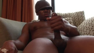 hung black stud posing nude on balcony