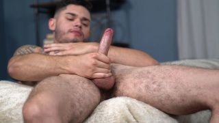 sexy guy Ruben strokes his big dick