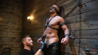 Chad Stone chained up and used in first dungeon scene