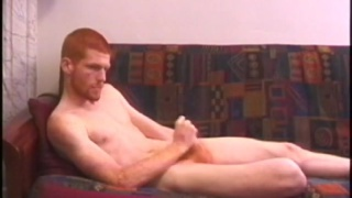 Red-haired skater punk jerks his cock