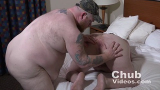 big bear chub lies back while guy rides his cock