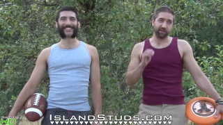 Bearded Andre & Mark play naked frisbee outdoors