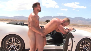 Brysen & Blake Bareback outside on their car