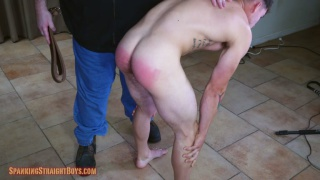 handsome guy spanked with a hand and leather strap