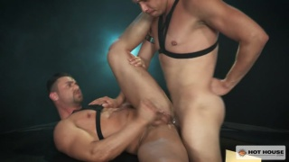leather men fuck in a dark room