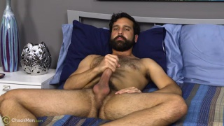 hairy guy strokes his eight inches