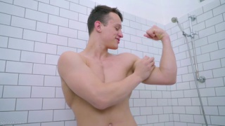 Hung muscle jock Alexei Vasiliev strokes his big cock
