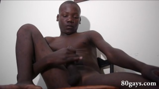adorable african twink sits on a chair and jacks off