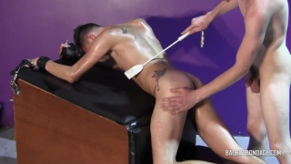 master ties down his boy and beats him with a crop