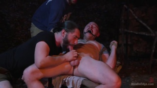 two guys tie up a straight camper and edge him all night
