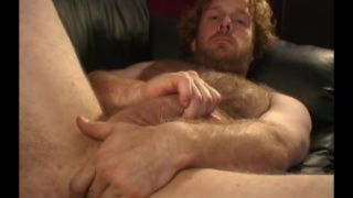 scruffy and bearded Joey jerks his cock