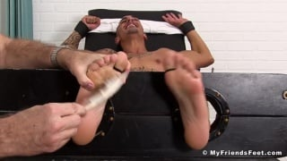 Rico Romero strapped in the tickling chair