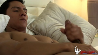 muscle hunk strokes his long cock