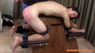 straight guy strapped to the spanking bench