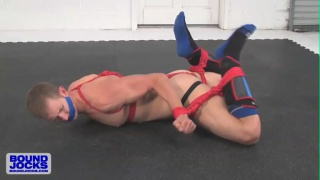 Bound Johnny Lawless fingers his hole on the flow
