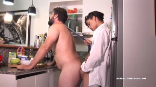 daddy's in the kitchen making coffee when his boy arrives home