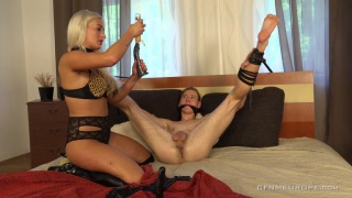 blond dominatrix dildo fucks a bound guyt