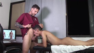 patient lies on exam table and sucks his doctor's cock